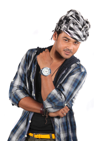 A young stylish Indian model posing in front of a white studio background.