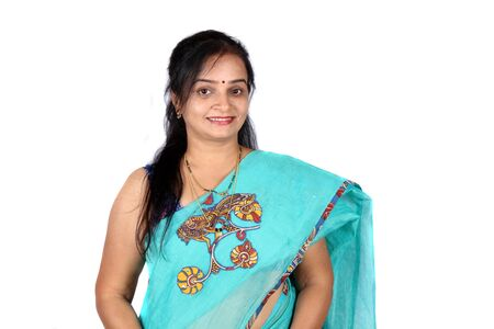 A beautiful middle aged Smiling Indian woman, on white studio background.