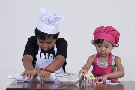 boy and girl cooking photo