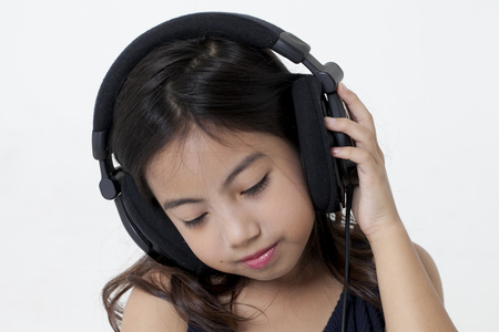 Girl listening to music on headphone