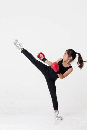 A little girl kicking 写真素材