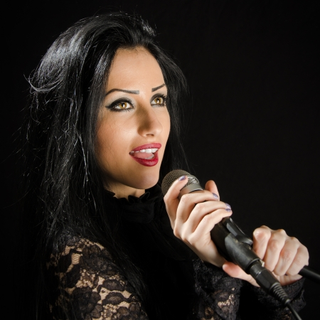 Young Woman Singing With Microphone