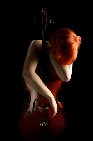 Woman Leaning Against Cello photo