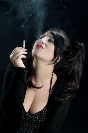 passionately: Woman Passionately Smoking Stock Photo