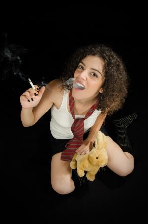 Teen-Looking Young Woman Smoking photo