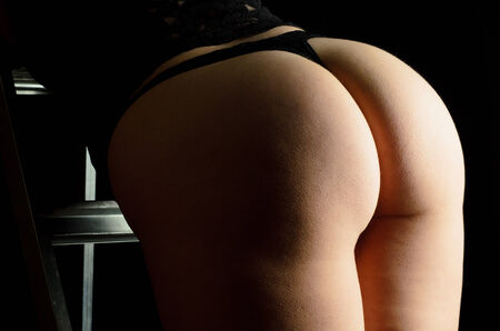 Female Buttocks With Black Underwear photo