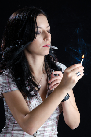 Woman Lighting Up a Cannabis Joint photo
