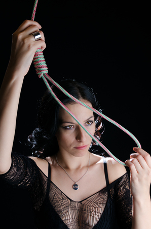 noose: Woman With Hanging Noose Stock Photo