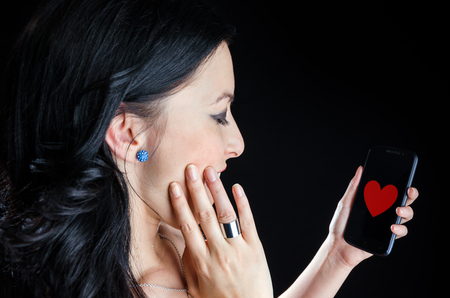 Happy Woman With Heart Image on Phone Stock Photo