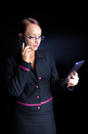 Woman With Phone and Laptop