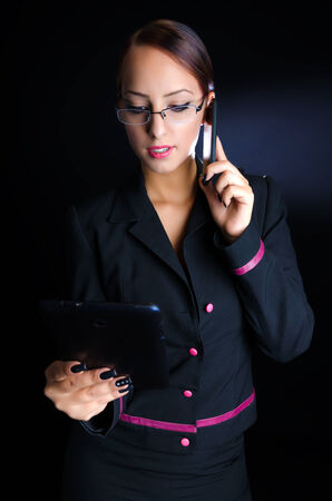 Woman With Tablet Computer and Phone