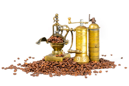 Coffee Grinders With Beans on White Stock Photo