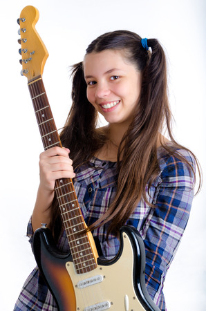 Female child holding an electric guitar against a white background Stock Photo