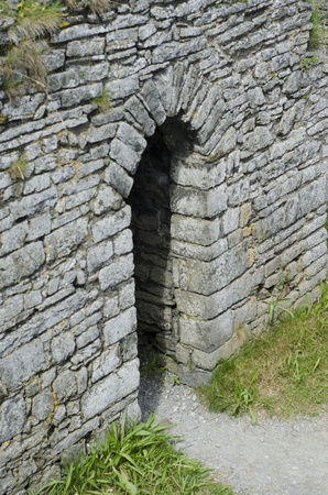 A castle doorway from above with a path leading to it. Stock Photo