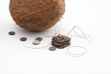 A Coconut next to handcrafted buttons