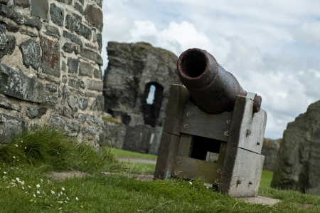13th century: 13th century castle ruins with authentic cannon Stock Photo