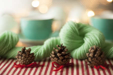 Vintage Christmas decorations on a table, with red and cream candy striped, peppermint green and turgouise features