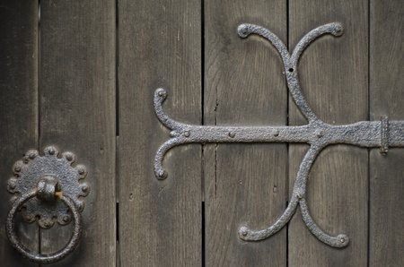 Closeup of wrought iron metal work on old oak door of church. Stock Photo - 15071619