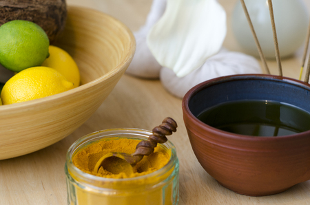 remedy: A table top arrangement of spice, oil and massaging tools, used in Ayurveda massage.