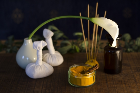 A table top arrangement of spice, oil and massaging tools, used in Ayurveda massage.