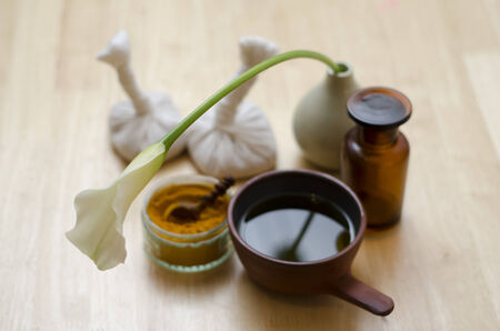sandalwood: A table top arrangement of spice, oil and massaging tools, used in Ayurveda massage