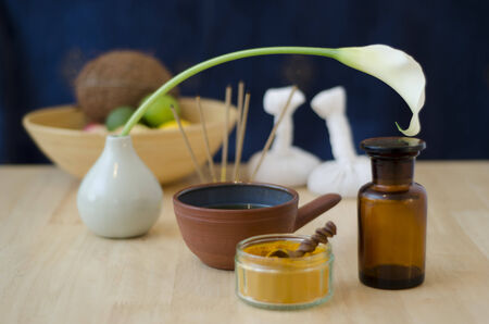 A table top arrangement of spice, oil and massaging tools, used in Ayurveda massage