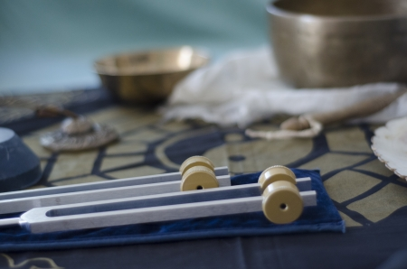 sound healing: A wo healing tuning forks with Tibetan singing bowls and tingsha in the background