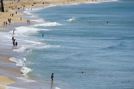 passtime: People of multi generation families enjoying seaside recreation and passtime on beach