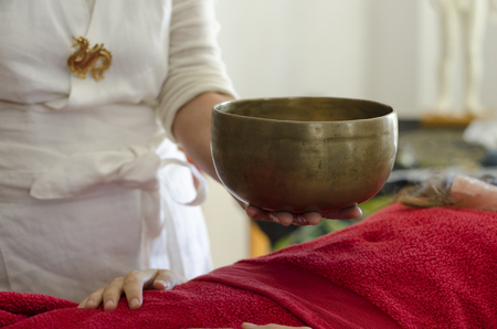 Practitioner  healing  with Tibetan singing bowls Stock Photo - 25205439