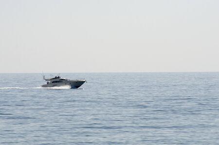 A small cruiser boat in the mediteranean sea Stock Photo