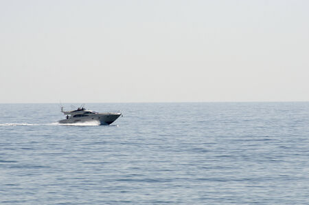 plage: A small cruiser boat in the mediteranean sea Stock Photo