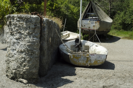 A small old boat sitting in the sand whne the tide is out in Newquay