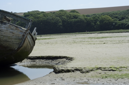 An old boat wreck in the sand in Newquay