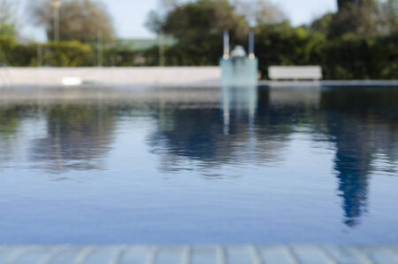 Swimming pool taken from low position with blurred background Stock Photo