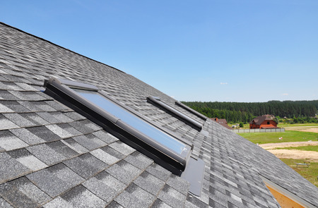 solar panel roof: Beautiful roof windows and skylights Stock Photo