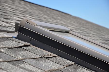Skylight or Roof window with closeup focus on bitumen-based waterproofing membrane areas Stockfoto