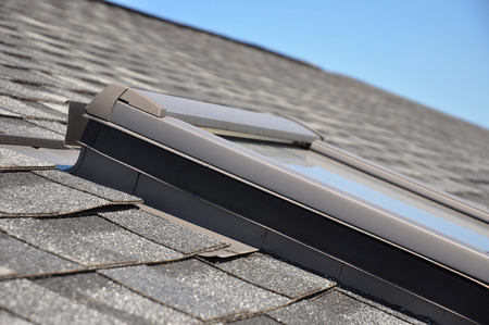 roofing membrane: Skylight or Roof window with closeup focus on bitumen-based waterproofing membrane areas Stock Photo