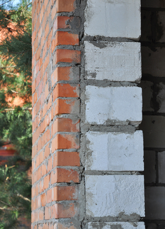 rock wool: Termal insulation of a house brick wall on a building site. Closeup.