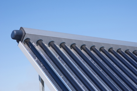 Closeup of vacuum solar water heating system on the house roof.Energy efficiency Stock Photo
