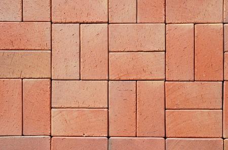 Moderno rosso piastrelle clinker ceramico. finitrici piano in un percorso, particolare di un marciapiede a camminare, con texture di sfondo