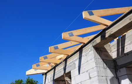 rafters: Installation of wooden beams at construction the roof truss system of the house
