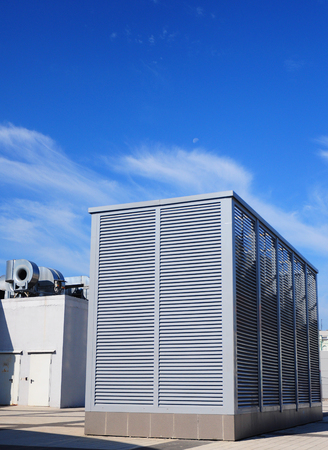 Industrial air conditioning and ventilation systems on the street against clody sky. Ventilation system of factory. Stock Photo