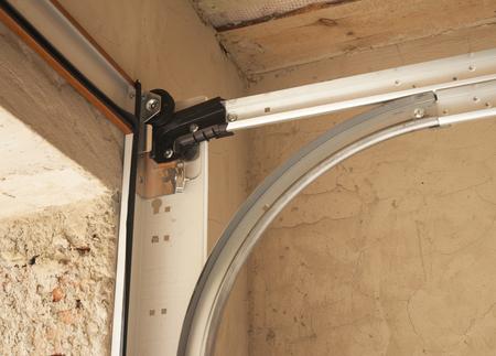 Garage door openers system. Close up on Detail of Garage Door Installation Stock Photo