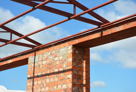 lintels: Window lintel construction. Steel roof trusses details with bricklaying frame windows construction. Steel Lintels. Stock Photo