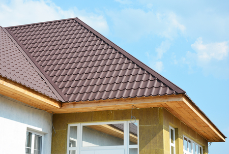 conservatory: Roofing house and rock wool wall insulation detail. Building insulation exterior, added to buildings for comfort and energy efficiency. Soffit and Fascia installation.