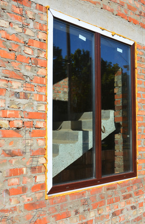 lintel: Window installation and Replacement Details with Concrete Lintel. Window Construction with Insulation.