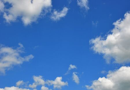 Blue clouds sky with blue background and copy space. Beautiful summer sky with clouds. Stock Photo