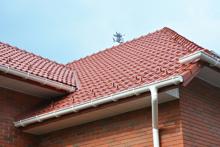 House Problem Areas for Rain Gutter Waterproofing. Guttering, Gutters, Plastic Guttering, Guttering & Drainage. Guttering Down pipe Fittings Stock Photo - 75045495