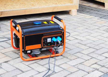 Gasoline Portable Generator on the  House Construction Site. Close up on Mobile Backup Generator .Standby Generator - Outdoor Power Equipment 스톡 콘텐츠