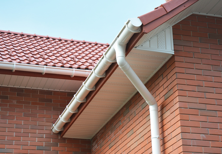 Close up view on House Problem Areas for Rain Gutter Waterproofing Outdoor. Home Guttering, Gutters, Plastic Guttering System, Guttering & Drainage Pipe Exterior Stock Photo